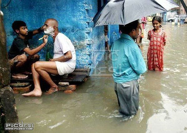 Only in India Shaving in Floods India Funny Picture