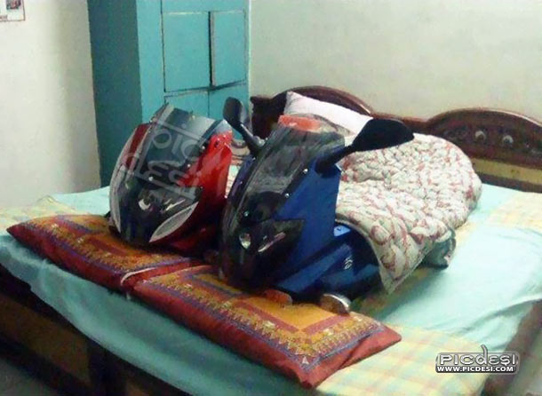 Couple in Love Funny Bikes on Bed India Funny Picture