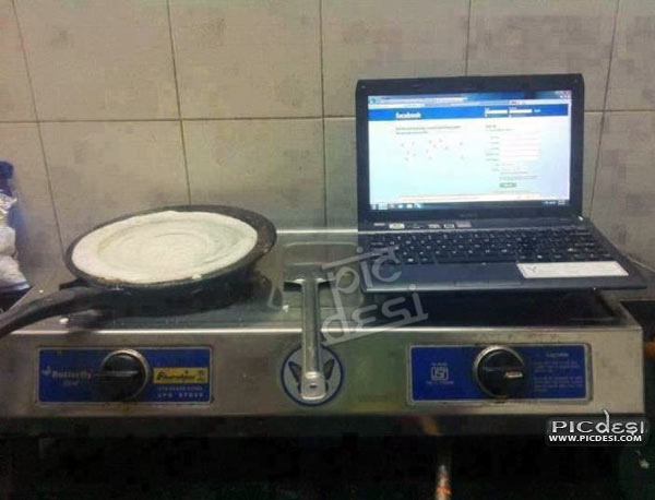 Facebook Addict Laptop in Kitchen India Funny Picture